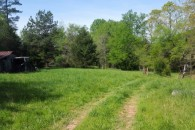95 Acre Family Farm With Hardwoods, Creek, Foodplots and Barns at  for 2250